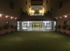 Hotel Photo: Narjes Al Hadeqa Hotel