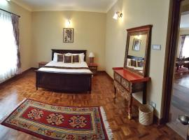 Hotel Photo: Boutique Tibetan Dragon Room at Karma Suites