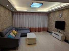 酒店照片: Seaview Apartment Near Tiyu Park