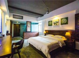 A picture of the hotel: Xishuangbanna Zuishiliunian Boutique Guesthouse