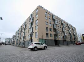 A picture of the hotel: Cozy and stylish one-bedroom apartment in Jätkäsaari, Helsinki (ID 7472)