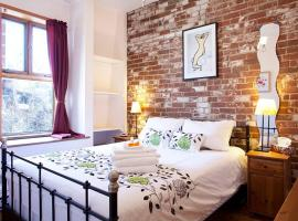 A picture of the hotel: Beautiful 1 BR w/ brick & stone walls near DT