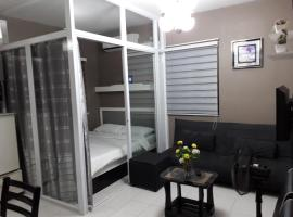 A picture of the hotel: Gwentop Condotel at One Metropolitan Place Condominium