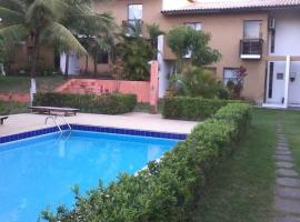 A picture of the hotel: Village 2/4 Condominio em Itapua