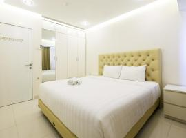 Hotel fotoğraf: 1BR The Wave Apartment near Kota Kasablanka By Travelio