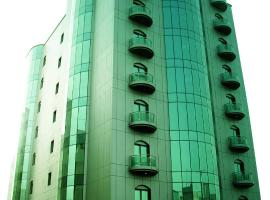 A picture of the hotel: Al Madina Suites Doha