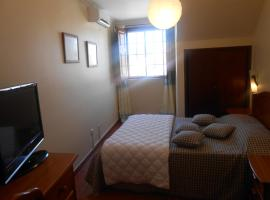 A picture of the hotel: Apartamentos Turisticos Queluz