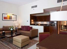 A picture of the hotel: Grand Millennium Al Wahda Hotel Apartment