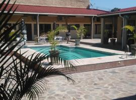 A picture of the hotel: Palmeiras Guest House Matola