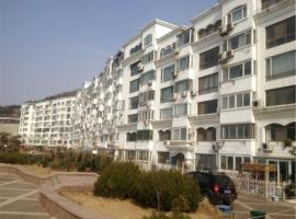 Hotel Photo: Qingdao Dusco Holiday Apartment Shilaoren Park