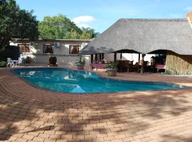 A picture of the hotel: Die Rooi Windpomp