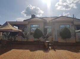 Foto di Hotel: Mpiga Executive Lodge