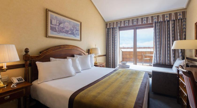 Best time to travel Spain Hotel Exe Reina Isabel