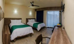 Deluxe Double Room with Two Double Beds (2 Adults + 2 Child)