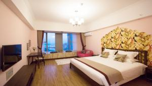 Xinlong Holiday Inn University of Petroleum, Мини-гостиницы  Huangdao - big - 24