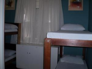 Bed in 4-Bed Female Dormitory Room with AC