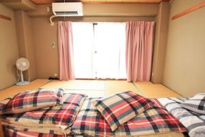Osaka Moon Story Apartment 507, Appartamenti  Moriguchi - big - 9