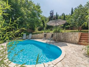Three-Bedroom Holiday Home in Tinjan, Case vacanze  Tinjan - big - 25