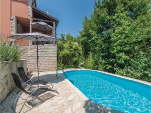 Three-Bedroom Holiday Home in Tinjan, Case vacanze  Tinjan - big - 24