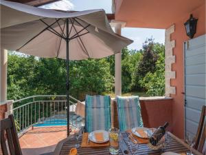 Three-Bedroom Holiday Home in Tinjan, Case vacanze  Tinjan - big - 21
