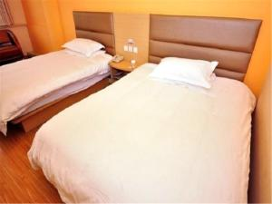 Grace Inn Jinan Exhibition Center Olympic Road Branch, Проживание в семье  Цзинань - big - 5
