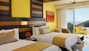 Junior Suite Ocean Front with Two Double Beds