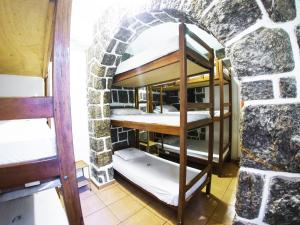 Single Bed in Female Dormitory Room (9 Adults)