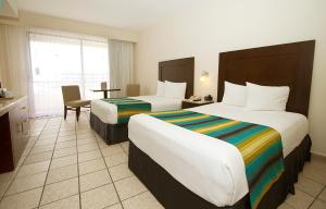 King or Double with Ocean View  (1 Adult + 2 Children)