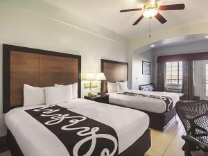 Two Queen Beds with Partial Ocean View