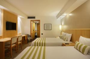 Deluxe Triple Room with Two Double Beds