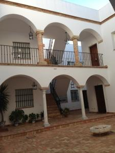 Foto Quartos City Apartments Carmona