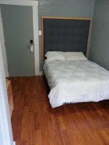 One Double Bed with Shared Bathroom