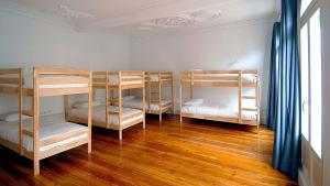 Bed in 8-Bed Dormitory Room with Balcony