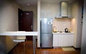 Chenlong Service Apartment - Yuanda building, Aparthotels  Shanghai - big - 12
