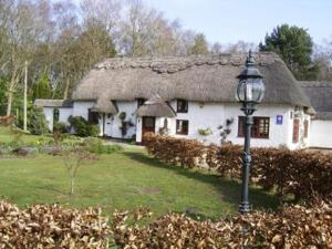 Thatch Cottage Guest House in Three Legged Cross, Dorset, England