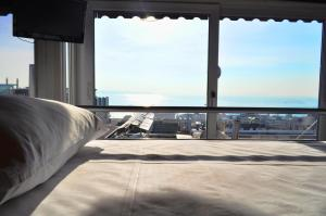 Bed in 4-Bed Mixed Dormitory Room with Sea View