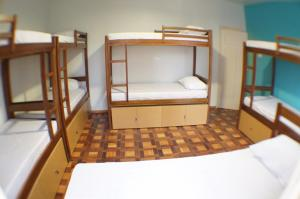 Bed in 9-Bed Mixed Dormitory Room with Shared Bathroom