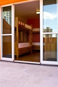 Bed in 6-Bed Female Dormitory Room with Internal Bathroom and Balcony