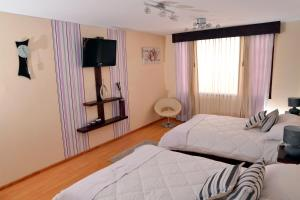 Ficoa Real Suites, Отели  Ambato - big - 17