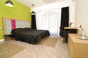 El Quatro - Boutique Hotel, Hotely  Gura Humorului - big - 12
