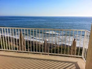 Oceanfront Holiday Home with Balcony and Views