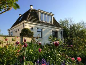 Bed & Breakfast Koetshuis De Hulk