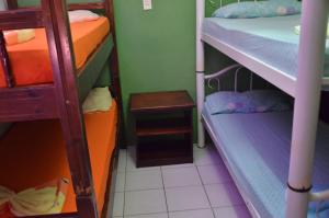 Bed in 8-Bed Male Dormitory Room with Shared Bathroom