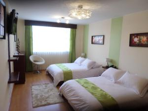Ficoa Real Suites, Отели  Ambato - big - 13