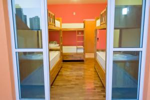 Bed in 6-Bed Mixed Dormitory Room with Internal Bathroom and Balcony