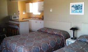 Quadruple Room with Two Double Beds and Kitchenette