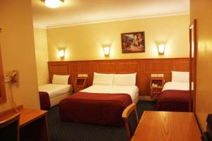Quadruple Room with One Double and Two Twin Beds - Non-Smoking