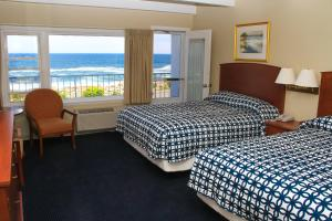 Deluxe Queen Room with Two Queen Beds with Balcony and Ocean View