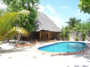 Photo of Paradise Villas   Mapenzi Bungalow