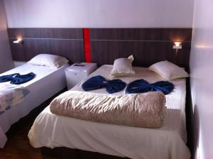 Economy Triple Room (1 Double Bed + 1 Single Bed)